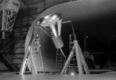 Here, a technician checks the Mercury full-scale capsule model prior to testing in the Full-Scale Tunnel in 1959.