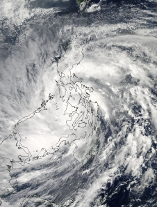 As Super-Typhoon Haiyan moved over the central Philippines on Nov. 8 at 05:10 UTC/12:10 a.m. EDT, the MODIS instrument aboard NASA's Aqua satellite captured this visible image. Image Credit: NASA Goddard MODIS Rapid Response Team. Caption by NASA.
