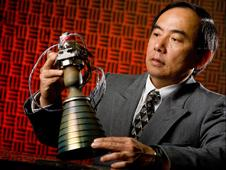 Dr. Huu Trinh holds a small rocket engine