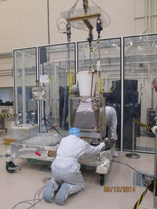 Cleanroom workers positioning the GOES-R GLM Sensor Unit to measure its total mass and center-of-gravity.