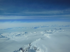 A view of Antarctica's ice sheet and mountains seen from a U.S. Air National Guard LC-130 aircraft during a flight to the South Pole in December 2012.