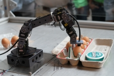 robotic arm and a carton of eggs