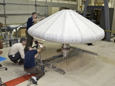 NASA engineers check out the Inflatable Re-entry Vehicle Experiment (IRVE) in the lab.