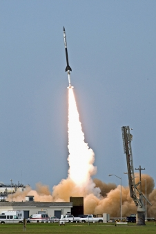 Image of the Black Brant 9 rocket taking off from it's launchpad.