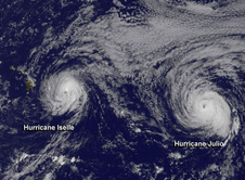 This GOES-West satellite image from August 7 at 1800 UTC (2 p.m. EDT) shows Hurricane Iselle approaching Hawaii and Hurricane Julio behind to the east.