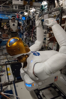 NASA astronaut Chris Cassidy works with Robonaut 2 aboard the International Space Station.