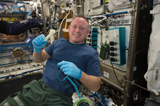 "International Space Station Commander Barry ""Butch"" Wilmore shows off a ratchet wrench made with a 3-D printer on station."