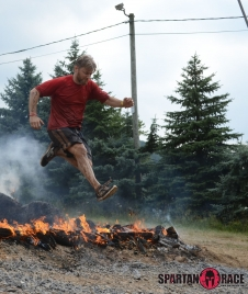 John jumping the fire pit during his Spartan race