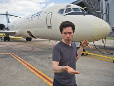 Comedian Mark Malkoff is spending the entire month living on AirTran airliners to try to overcome his fear of flying.