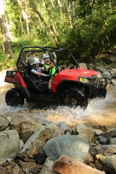 Colleen 4-wheeling in a dune buggy in the mountains of Puerto Vallarta, Mexico with husband, Bill