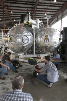 Technicians prepare the Project Morpheus lander to be moved to a support building.
