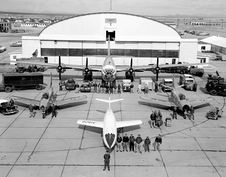 An aerial view of the NACA's fleet of test aircraft assembled in front of the hangar.