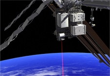 This artist's concept shows how the Optical Payload for Lasercomm Science (OPALS) laser beams data to Earth from the International Space Station.
