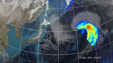 A satellite swath over a Pacific storm transforms gray clouds into colors