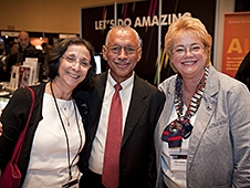 Charles Bolden stands between two women