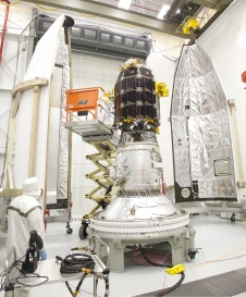Engineers encapsulate the LADEE spacecraft into the fairing of the Minotaur V launch vehicle.