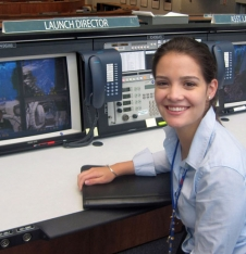 Carolina Ragolta sits in the Launch Director seat in a mission control room