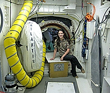 Carolina Ragolta sits near the entry hatch to space shuttle Atlantis