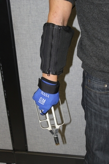 Demonstration of RoboGlove providing assistance with a grasping task.