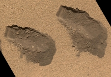trenches dug by Curiosity in 2012 to collect soil samples