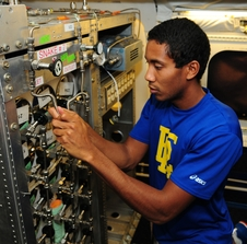Jonathan Hemingway, an applied meteorology and computational mathematics major at Embry-Riddle Aeronautical University in Florida, assists in installation of the Whole Air Sampler instrument on NASA's DC-8 flying laboratory.