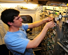 Caleb Sykora-Bodie, an environmental geoscience and geography major at Slippery Rock University, connects lines during installation of the Whole Air Sampler instrument for the SARP flights.