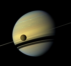Saturn is pictured here with its largest moon, Titan, in a mosaic taken by the Cassini spacecraft's wide-angle camera.