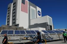 The solar power generator prototype was unfolded in the Vehicle Assembly Building parking lot in 2011