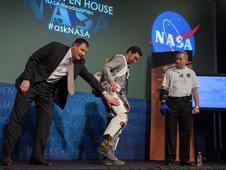 Bill Bluethemann, left, Roger Ronekamp, center, and Jonathan Rogers, all engineers at NASA Johnson Space Center perform a demonstration of NASA's exoskeleton technology during the NASA Open House at NASA Headquarters, Friday, Jan. 18, 2013, in Washington.