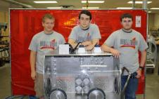 Students from Cypress Woods High School who helped to build this Microgravity Science Glovebox Trainer in coordination with HUNCH.  From left to right, Ben Holloway, Helmut Brenner, Robert Lipham (not pictured – Alie Derkowski).