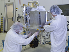 Technicians prep the OCO-2 instrument for shipping at JPL.