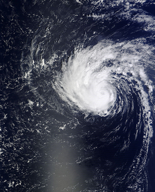 satellite view of hurricane over ocean with sunglint
