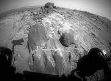 The flat-faced rock near the center of this image is a target for contact investigation