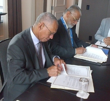 NASA Administrator Charles Bolden (left) and Chairman K. Radhakrishnan of the Indian Space Research Organisation signing documents in Toronto on Sept. 30, 2014 to launch a joint Earth-observing satellite mission and establish a pathway for future joint missions to explore Mars.