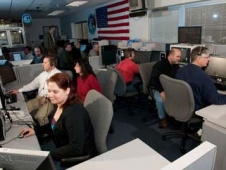 Employees staffing the telescience center.