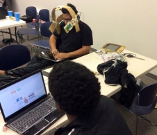 Team Spacewear tests their prototype astronaut helmet to send and receive text messages at the Kennedy Space Center Space Apps Challenge.