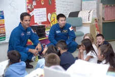 NASA astronauts talk with local school children.