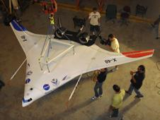 Technicians oversee preparations for testing the modified X-48C configuration in NASA Langley Research Center's full-scale wind tunnel.