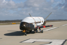 In a testing procedure, the X-37B Orbital Test Vehicle taxis on the flightline in June 2009 at Vandenberg Air Force Base, Calif.