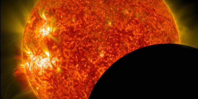NASA's Solar Dynamics Observatory captured this image of the moon crossing in front of its view of the sun on Jan. 30, 2014.
