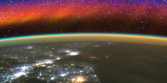 The lowest reaches of space glow with bright bands of color called airglow in this image