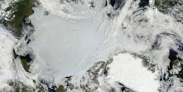 2011 composite satellite image shows the expanse of Arctic sea ice (center) and the Greenland Ice Sheet (lower right)