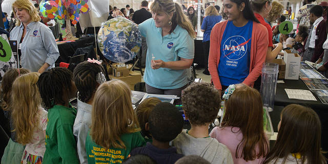 Visitors explore the exhibits at NASA's Earth Day event at Union Station in Washington, DC, Friday, April 22, 2016.
