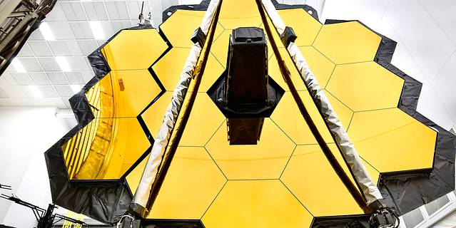 James Webb Space Telescope primary mirror at Goddard being prepared for testing at Johnson Space Center.