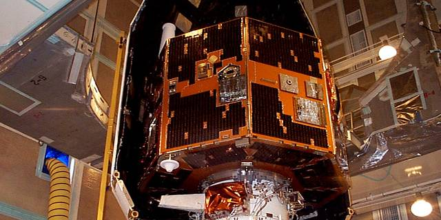 IMAGE spacecraft being enclosed in its fairing prior to launch