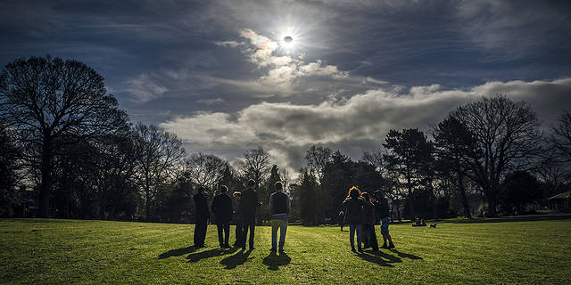 people watching a partial eclipse