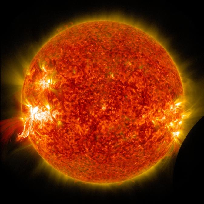 NASA's SDO Sees a Solar Flare and a Lunar Transit | NASA