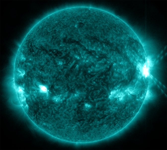 An X1.0-class flare exploded off the right side of the sun, peaking at 10:03 p.m. EDT on Oct. 27, 2013.