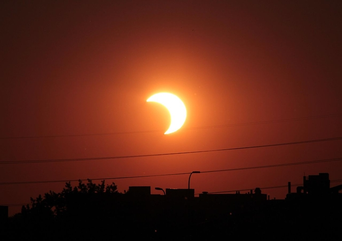 A partial solar eclipse occurs when the moon obscures only part of the sun from Earth's view. Credit: T. Ruen