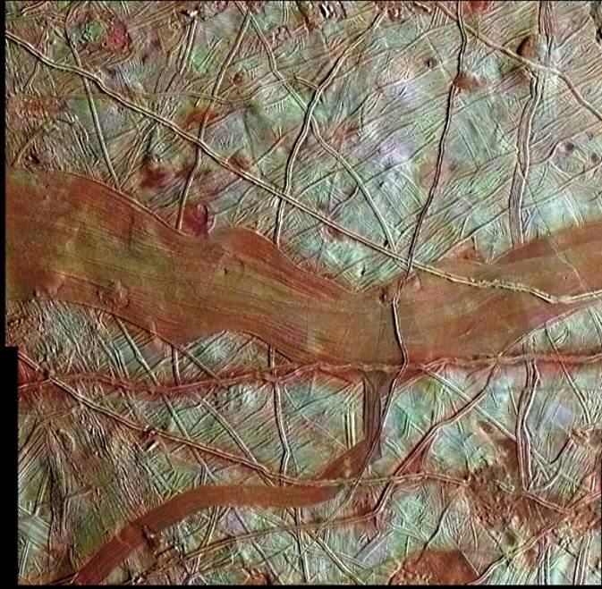 Compiled from NASA's Galileo spacecraft data, this colorized surface image of Europa shows the blue-white terrains which indicate relatively pure water ice.